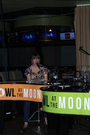 One half of Howl at the Moon playing the piano.