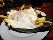 This serving of poutine at Kuprose Bistro had exactly one piece of meat in the short-rib gravy. Whatever white cheese that was on top wasn't in curd form; it was melted.