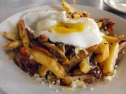 Disco fries at The Eatery feature skin-on fries tossed with shards of bacon, topped with a fried egg and a flurry of parmesan cheese. It's breakfast, lunch and dinner in a bowl.