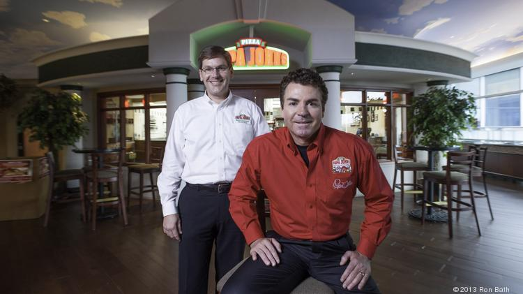 Tony Thompson, president and chief operating officer and John Schnatter, CEO, founder and chairman of Papa John's International Inc., are shown at the company's Louisville headquarters.