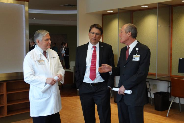 Gov. Pat McCrory, center, talks with Dr. John McConnell, Wake Forest Baptist CEO,  and Dr. Edward Abraham, dean of the Wake Forest School of Medicine, during his tour of the expanded Comprehensive Cancer Center on Tuesday.