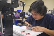A Zazzle employee stamps cupcake buttons. The company sold 15,000 custom buttons during the week of Black Friday.