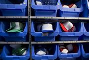 To keep up with the demand Zazzle has to keep a huge back stock of t-shirts, hats, buttons and other printables at the factory.