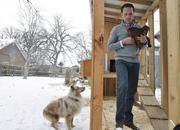 Patrick Quinlan, CEO of Convercent and a veteran entrepreneur, at home with the dogs and chickens in his Park Hill neighborhood. (December 2013)