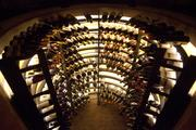 Wine is stored in a semi-circular rack at the bottom of a short stairway at Sotto.