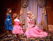 Princess Aurora holds court with the target audience at Magic Kingdom's Princess Fairytale Hall.