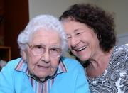 Laura Aromando laughs at a joke from her mom Margaret Armento. The 93-year-old Armento is one of many seniors receiving at-home care from their professional children due to the rising cost of assisted living facilities.