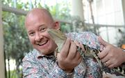 Dustin Houck holds an alligator in the Nature Works gallery at Orlando Science Center during the OBJ 2013 40 Under 40 photo shoot.