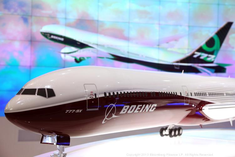 A model of Boeing's 777X aircraft sits in front of a picture display for the new aircraft on the company's stand during the 13th Dubai Airshow at Dubai World Central (DWC) in Dubai, United Arab Emirates, in November. The St. Louis Dispatch newspaper obtained the RFP for the Boeing plant and listed the requirements that  the company is seeking.