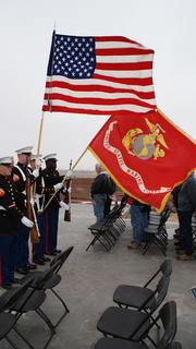 """A Marine color guard kicks off the ground-breaking ceremony Saturday for the new Mount Hope home of Marine Sgt. James """"Matt"""" Amos."""
