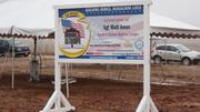 """Homes for Our Troops has a sign at the site marking the project for Marine Sgt. James """"Matt"""" Amos."""