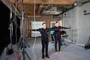 To calibrate the cameras to the suits, KGW reporter Joe Smith and Clackamas Community College's Andy Mingo stand in the T-pose. The LED sensors are placed along the joints and then picked up by the cameras.