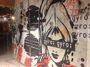Full-wall mural in the glass-encased conference room at Gyro's LoDo office space.