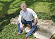 April: Trammell S Crow in the yard of his Dallas home, was the foucs of an article on Earth Day Dallas.