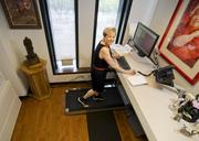 August: Nora Hogan, Principal of Transwestern at her treadmill desk. She was featured in an article about how some companies are adopting more-healthful work environments for their employees.