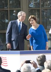 April: George and Laura Bush wave to their daughters, Jenna and Barbara, at the dedication ceremony of the George W. Bush Presidential Center.