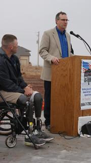 Greg Burden, executive director of the Kansas Commission on Veterans Affairs, speaks during Saturday's event.