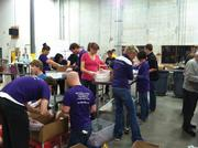 Affinity Plus employees packed food in October at Second Harvest Heartland.