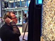 PJ Pårson, board member at Stockholm-based Spotify and venture capitalist with Northzone, checks out interactive art using Google Glass at SIME MIA 2013.