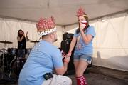 Jordan Patterson got down on one knee to propose to girlfriend Lindsay Bain after the pair was crowned king and queen of BaconFest.