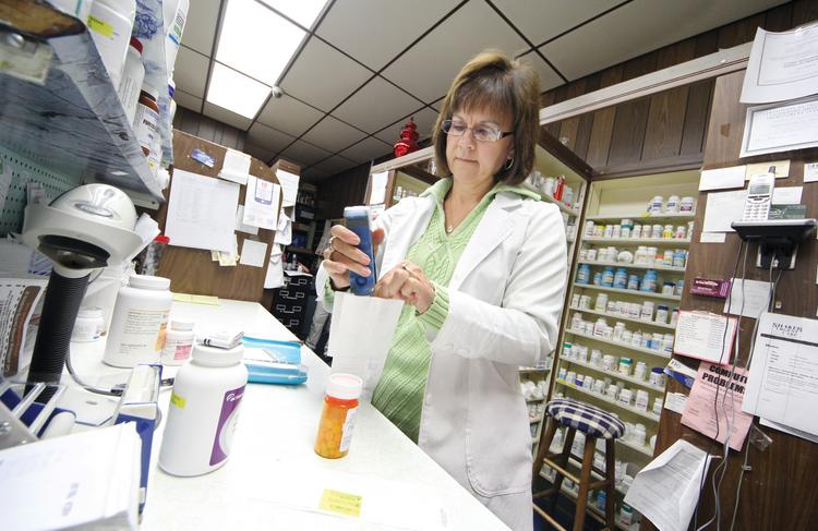 Pharmacist Barb Hoffman, owner of Scottdale Pharmacy in Scottdale, Westmoreland County, fills a customer's prescription.