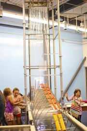 Visitors to the Currents exhibit will get wet as they explore the concepts of fluid dynamics and the connections between water and sound.