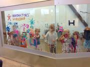 Another Innovator's Workshop encourages children to paint on the wall to explore their artistic side.