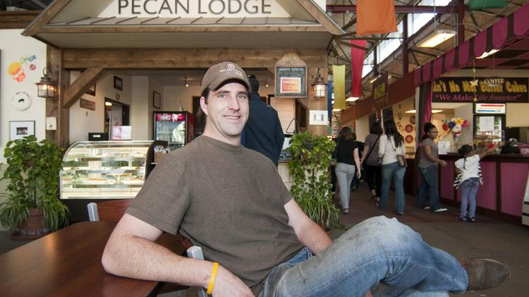 Justin Fourton sits outside Pecan Lodge, which was formerly located in the Farmers Market.