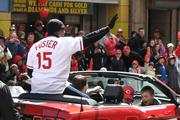 George Foster waves to Reds fans along the parade route.