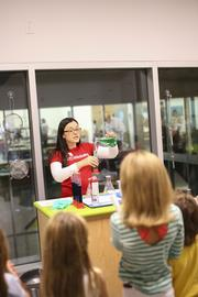 Kitchen Lab Coordinator Heather Peete demonstrates a science experiment.