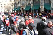 Crowds gather on Race Street to watch the Findlay Market Opening Day Parade.