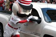 Mr. Redlegs marches in the Opening Day Parade.