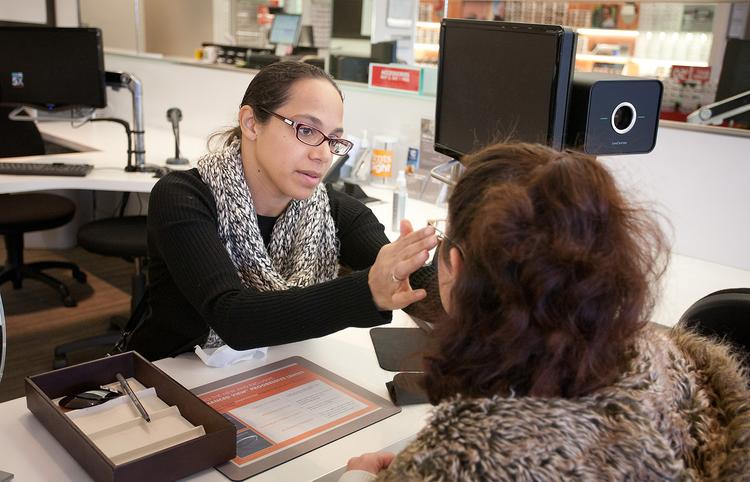 Sales supervisor Makana Puentes assists a customer at a LensCrafters store in Fair Oaks. Superior Vision has a wide network that includes retailers such as LensCrafters.