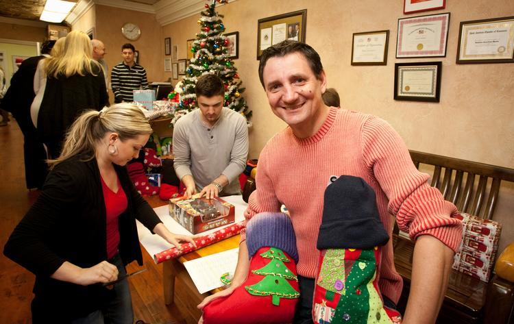 Members of the Russian-American  community joined Sergey Ivannikov, CEO of Russian American Media and community leader in Sacramento, this week as they wrapped presents for needy children.