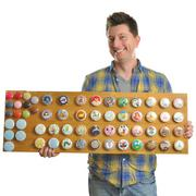 Scott Fuller of Etsy's The Character Chest shows off his custom-made wooden knobs.