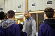 Caron Butler greets young basketball players at the John Bryant Community Center in Racine, where he and his wife also gave away 200 turkeys for Thanksgiving.