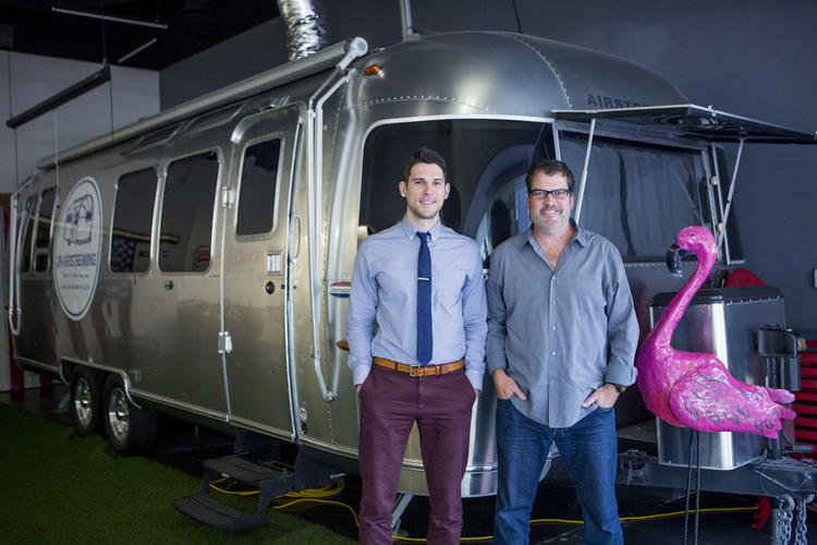 Paul Boukadakis, left, and JP Hager with their Airstream trailer used by their company for live music performances that are released as videos.