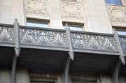 An ornate walkway along the south face of the Power & Light Building stands out for its Art Deco details.