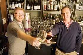 FoodBevInnovators_free flow wines.  Dan Donahoe(dark top) and Jordan Kivelstadt(light top) demonstrate thier free flow wine set up at the Corner Store Bar and Restaurant in SF
