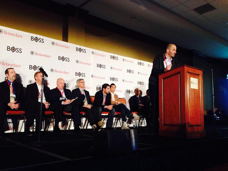 A lineup of speakers at the BOSS conference Dec. 5, in Troy. Some 80 people, including CEOs and entrepreneurs, addressed the audience for five minutes each, presenting one slide of information and offering three takeaways. The event, a first-of-its-kind for the Capital Region, was hosted by Rensselaer Polytechnic Institute.