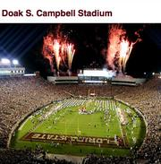 Florida State University City:  Tallahassee Population:  186,971 Median income:  $38,607 Stadium/capacity:  Doak Campbell Stadium (82,300) Football revenue:  $43.1 million Football coach/total pay:  Jimbo Fisher ($2.7 million)   Ohio State University City:  Columbus Population:  809,798 Median income:  $40,463 Stadium/capacity:  Ohio Stadium (102,329) Football revenue:  $70.9 million Football coach/total pay:  Urban Meyer ($4.6 million)