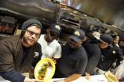 Tupelo Honey employees test out recipes in the new kitchen.
