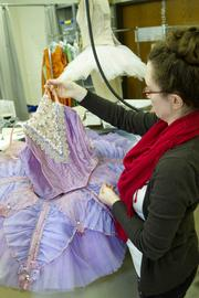 Erin Rollins, assistant costume shop manager, checks over a Sugar Plum Fairy costume.