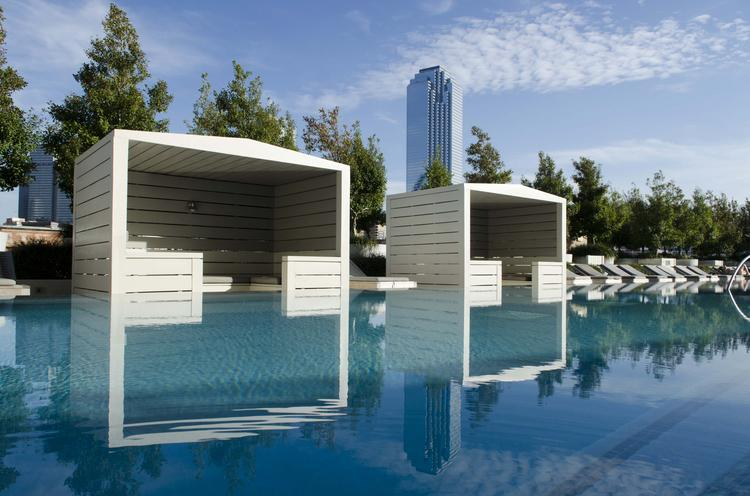 The 130-foot lap pool, hot tub, private cabanas and outdoor fireplace have a tree lined view of downtown.
