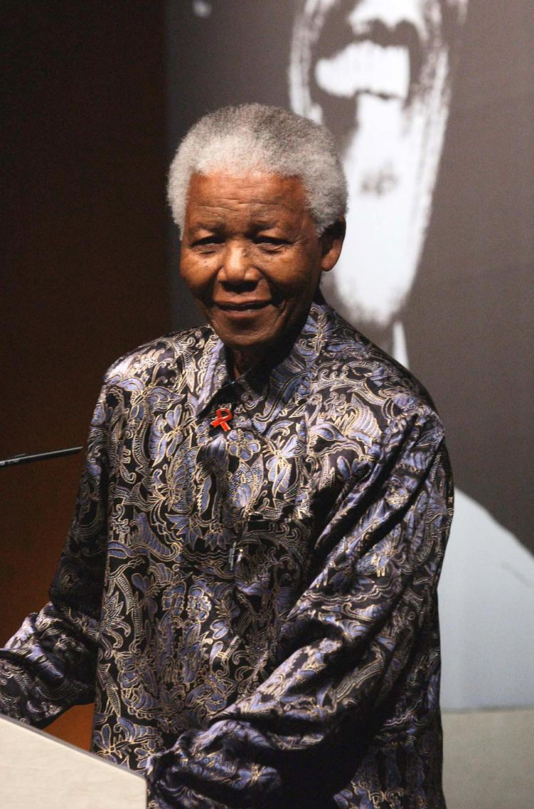 Former South African President Nelson Mandela speaks at a press conference in central London on Oct. 21, 2003.