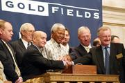 Former South African President Nelson Mandela, center, is joined at the opening bell by New York Stock Exchange Chairman and CEO Richard Grasso, third from left; Christopher M.T. Thompson, chairman and CEO of South Africa-based gold mining company Gold Fields Ltd., second from right; and Ian Cockerill, managing director and COO of Gold Fields, right, in a 2002 photo.