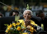 Nelson Mandela, former South African president, listens while Jacob Zuma, ANC president, addresses more than 120,000 supporters at an African National Congress election rally at Coca-Cola Park in Johannesburg, South Africa, on April 19, 2009.