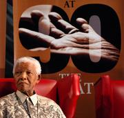 Nelson Mandela, the former South African president, listens to plans for the celebration of his 90th birthday in Johannesburg, South Africa, on March 5,  2008.