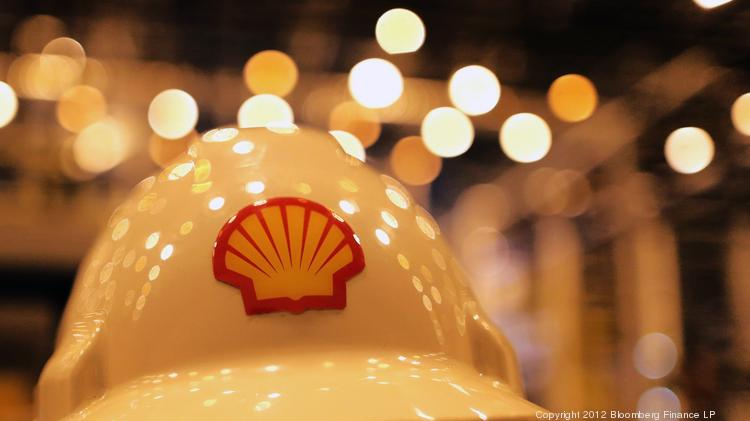 A Shell logo is emblazoned on a safety helmet worn by a Royal Dutch Shell employee. The global oil giant is selling Eagle Ford Shale acreage to Sanchez Energy for $639 million.
