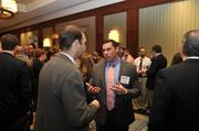"Attendees network before the Fast 50 awards program. Pictured is Brent Howison of The Remi Group.To obtain digital files or prints for your own use, send an email to nancy@nancypiercephoto.com with ""Fast 50"" in the subject line."